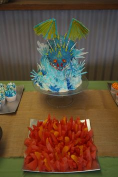 My take on Liz Larson's Stormfly cake with watermelon flames... I used more cake and less icing to compensate for my inferior figure piping skills and I was very happy with my effort, more importantly so was my 'Astrid'