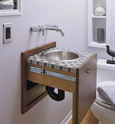 NOW THIS IS COOL! Bathroom Vanity with Tuck-Away Designed so the sink slides into the wall while the wall mounted faucet hints to where you wash up! Amazing for tiny space 1/2 bath!