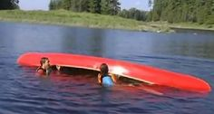 How to empty a swamped canoe from the water.
