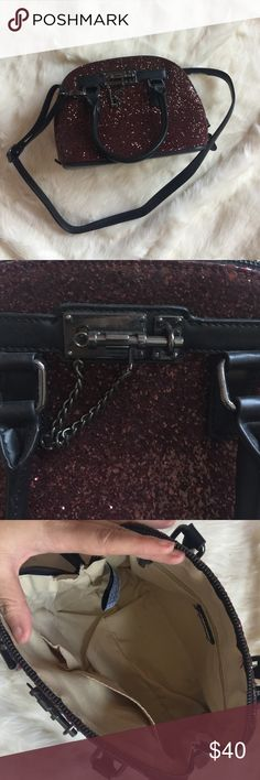 "Aldo Burgundy Glitter Bag Burgundy glitter Aldo mini bag. Top handle as well if longer strap. Done style shape with full zip around closure. Gunmetal hardware. 10.5"" x 5"" x 8"". Aldo Bags"