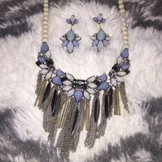 Beautiful blue white and silver necklace set Gorgeous blue, white, and silver statement necklace and earring set by Macy's. 18 inch necklace and earrings are 2 inches long Macy's Jewelry Necklaces