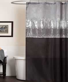 Shower in style with this classy curtain. Showcasing sequin embellishments and dual-tone fabric, this piece gives the bathroom a posh backdrop.