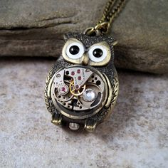 This handmade antique bronze steampunk owl necklace by Urban Metal Designs is as adorable as it is stylish. It's the perfect unique addition to a simple outfit and features a high-quality watch movement adorned with a Swarovski crystal. The delicate bronze link chain measures 30 inches in length.