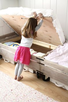 Crate beds with built-in storage. This shared bedroom is adorable!