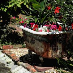 Bathtub turned into a planter! Want to do this with our old tub up against  the garage! | Crafts