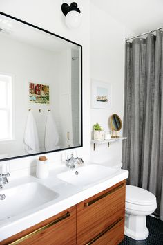 It's been almost one year since we completed our bathroom renovation. We've all but forgotten about the ten days of (backbreaking!) tiling, the endless search for an extra tall shower curtain and our funny little solution for that funny little sliver of space. We enlarged the footprint of this room…