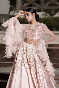 Rose pink hand embroidered tasseled blouse with volume lehenga set. Net Care: Dry Clean Only Muslim Wedding Dresses, V Neck Wedding Dress, Wedding Outfits, Indian Dresses, Indian Outfits, Pakistani Dresses, Lehenga Pattern, Lehnga Dress, Lehenga Choli
