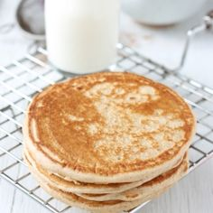 Eggless pancake with fruit and nut topping.  With warm cinnamon on the top.  No one will resist this pancake with topping.