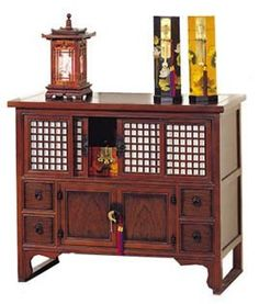 Japanese Shoji Door Lattice Chest by ORIENTAL FURNITURE. $684.99. Our classic Japanese Shoji Door Lattice chest is finished in our walnut brown with brass accents. The Shoji doors slide open for great storage space. . Dimensions: 41W x 19D x 34H
