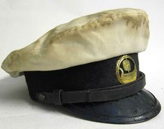 This vintage yacht cap is a copy of the one used by Richard Widmark in the film. It has been suitably aged & has a 'U-174' badge attached to the front.  It has a cotton top covering, vulcan-fibre peak and headband support, leather chinstrap, brass buttons, fully areated leather liner and many other features. Notice the shape - we have even got the shape to look 1950's 'Popeye' style.  www.warhats.com