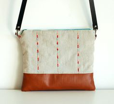 Red/turquoise/peach lines  linen and leather clutch  by mundoflo, €42.00