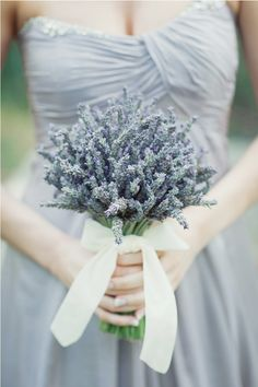 Silver bridesmaid dress with a lavender bouquet