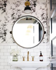 New guest bath: white subway tile with black grout, pedestal sink, dramatic wallpaper