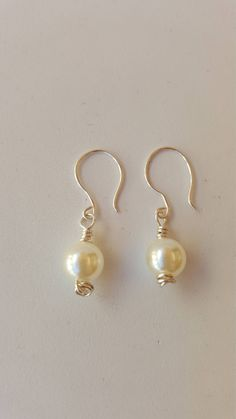 Handmade wire earrings - pearl earrings - Silver earrings - ladies earrings made with non tarnish wire and wire wrapped with a pearl bead by RickeJewelleryCraft on Etsy