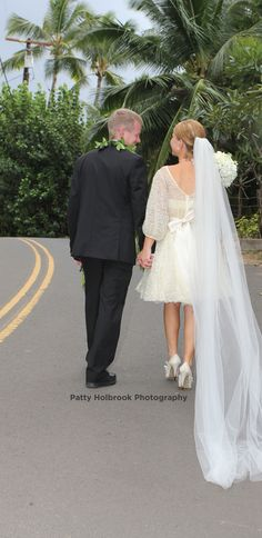 Bride And Groom Walking Hand In Must Have Wedding Picture Black Suit Maile Lei Short Vintage Lace Dress With Long Cathedral Veil