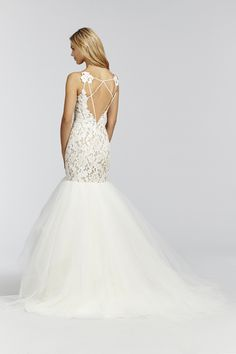 Kalea- 1650 Ivory lace fit to flare gown, elongated bodice with scalloped V-neckline, low open back with strap detail, tiered tulle skirt.