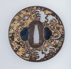 Tsuba with design of vine and foliage  Japanese, Edo Period, 18th century  School Kenjô School, Japanese, MFA