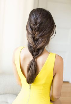 start by creating a normal three-strand braid and pull in random, alternating sections every couple of inches down the braid like you would with a French.