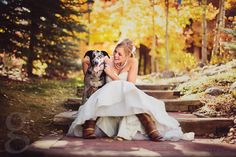 Beautiful fall bride getting a picture with her dog! So cute.