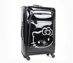 Add glamor to your travels with this soft Hello Kitty suitcase. A huge embroidered Hello Kitty in metallic thread pops against the glossy black background with its subtle quilt embossing. Multi-directional spinning wheels and a push-button extendible handle make this large case easy to maneuver. Part of the Hello Kitty Chic Travel collection.
