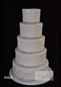 Buttercream iced 5 tier wedding cake with a silver and pearl finish