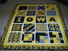 Go Hawkeyes!! Patchwork Quilt.  Does not have to be t-shirts I guess.  Can be a cotton quilt made with team colors and name.