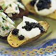 Potatoes with Caviar: An insanely easy very tasty appetizer.  Expensive caviar is not needed, the sub $ 15 kind works just fine.