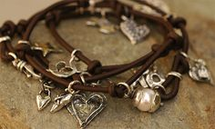 Leather Wrap and Charm Bracelet by cathydailey // $319 etsy