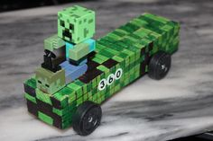 The Creeper Minecraft Pinewood Derby Car. My son did 95% of it. No cutting needed and he wanted to color it with markers.