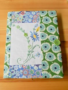 Notebook coveres made from vintage embroidered linens.