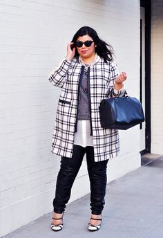 Leather pants edge up a plaid coat and pearl necklace.