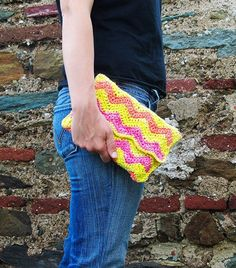 This Ripple Clutch Bag was designed by Tanya Eberhardt. It was crocheted with Medium Weight Yarn [4] and a 5 mm (H) hook.