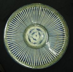 13th century bowl with central fish motif from Iran