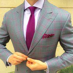 Grey blazer with fuchsia check, coordinated with fuchsia tie and pocket hankie
