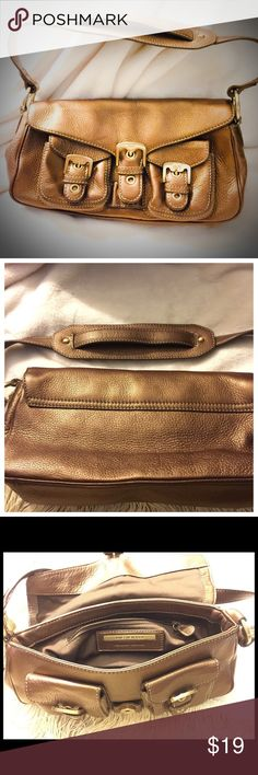 Beautiful Brown Leather Satchel SM Handbg Jones NY What a great Handbag by Jones of NY. This is genuine leather, soft and supple, with a pebbled leather in a beautiful brown color. The accents are in a brushed gold. A small bag, please see measurements. This bag is in great condition and ready to enjoy! Happy Poshing!✨✨ Jones New York Bags Satchels