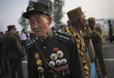 Old North Korean soldiers arrive in full military dress to pay their respects at the cemeteries of fallen fighters of the Korean People's Army (KPA) on Thursday, July 25, 2013 in Pyongyang, North Korea as part of ceremonies marking the 60th anniversary of the signing of the armistice that ended hostilities on the Korean peninsula. (AP Photo/Wong Maye-E)