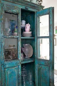 I need some sort of cool cabinet like this for my living room.  I would love for it to be turquoise and have chippy paint.