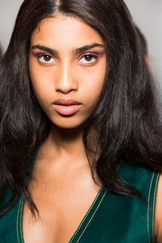 Spring 2015 Makeup Trend: Perfect Plum At Derek Lam, makeup artist Tom Pecheux created a glossy, mauve eye look by smudging on MAC lipstick in Violetta ($16, nordstrom.com) along with brown eyeliner.