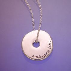 Embrace Life inscribed on beautiful silver necklaces and inspirational jewelry by Laurel Elliott dvb New York. Great for graduation jewelry gifts. Disc Necklace, Engraved Necklace, Heart Pendant Necklace, Graduation Jewelry, Graduation Gifts, The Embrace, Sterling Silver Necklaces, Live Life, Organic