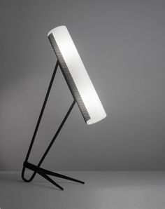 Lampe à abat-jour tube en perspex et métal perforé, pied en métal laqué noir France, c. 1950 Robert Mathieu éditionsP. 33 cm, H. 57 cm