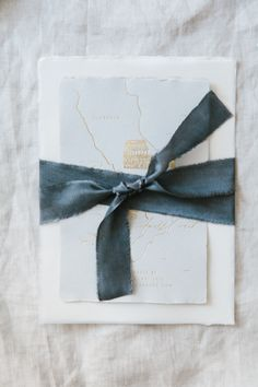 Calligraphy and Design by: Written Word Calligraphy // Dark Gray Silk Ribbons // Handmade Paper Invitations