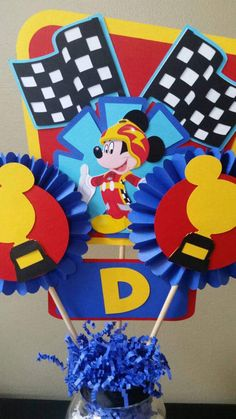 Check out this item in my Etsy shop https://www.etsy.com/listing/497346266/mickey-roadster-racers-centerpiece