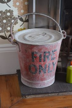 Original 20th Century fire bucket and lid used as a coal caddy