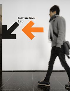 Love the starkness of this wayfinding. Instruction Lab - The Department of Advertising and Graphic Design Signage Display, Signage Design, Environmental Graphic Design, Environmental Graphics, Moma, Branding And Packaging, Marketing Branding, Identity Branding, Visual Identity
