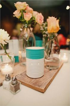 upcycled tin cans as candle lit luminaries   #tennesseewedding #weddingchicks http://www.weddingchicks.com/2013/12/27/family-affair-wedding/