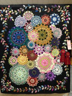 """I entered this quilt in the 37th Annual Drag and Brag Quilt Show at Paola, KS. ....Sept 25th, 2016... this is an English Paper Pieced quilt. It is the """"La Passacaglia"""" pattern designed by Willyne Hammerstein. It won second place ribbon for Pieced Bed Quilt and second place ribbon for Members Choice. The leaves in the border were made from all the material that I made """"fussy cut"""" holes in to create the cogs... so now i don't have any """"Holey"""" fabric in my stash ... LOL"""