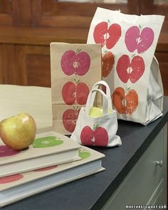 Apple Prints Apples aren't just for eating. The cut side of an apple half, dipped in candy-colored paint, can be stamped onto everything from canvas tote bags to book covers. Get the How-To