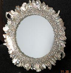 Sunburst mirror made of seashells - Beach Decor. $110.00, via Etsy.