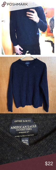 Vintage AE Sweater (90's) Navy Blue and Grey American Eagle Outfitters 90's sweater. Tag says XL however it fits like a men's M/S (must have been mis-laundered at some point) 50% lambs wool 50% cotton. Very warm! See last image for closest color match American Eagle Outfitters Sweaters V-Neck