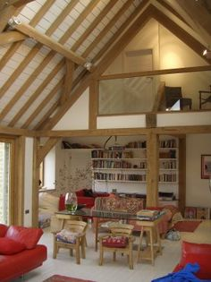 Barn room with exposed oak roof and painted timber boarding to house near Oxford